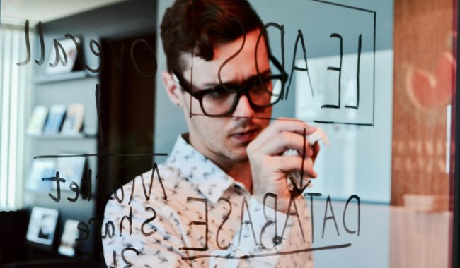tech leader writing notes on invisible board